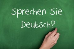 german-language-learning-hand-writing-sprechen-sie-deutsch-blackboard-45771499