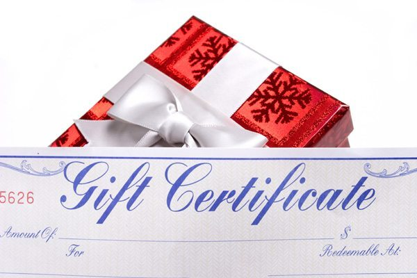 A gifts with bows with a gift certificate over white background